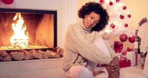 Beautiful black woman seated beside white tree stock video footage