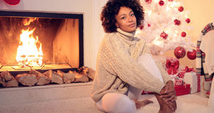 Beautiful black woman seated beside white tree Royalty Free Stock Photography