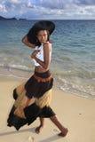 Beautiful black woman on the shore. Of a Hawaii beach at sunrise Stock Image