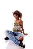 Beautiful black  woman, sitting on the floor Stock Photo