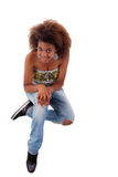 Beautiful black  woman, sitting on the floor Royalty Free Stock Photos