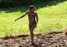 Beautiful Black Woman Smiling and Posing for Picture during Navy Mud Run. Beautiful Black Woman in Bikini Smiling and Posing for Picture while competing in the Royalty Free Stock Images
