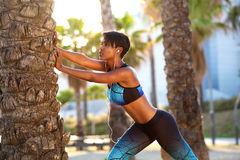 Beautiful black woman stretching workout routine Stock Photo