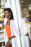 Beautiful black woman talking on phone and smiling Royalty Free Stock Images
