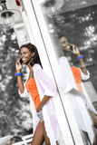 Beautiful black woman talking on phone and smiling Stock Photo
