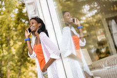 Beautiful black woman talking on phone and smiling Royalty Free Stock Image
