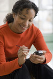 Beautiful black woman texting Stock Photos