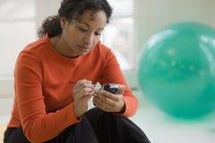 Beautiful black woman texting Stock Photos