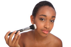 Beautiful black woman using make up powder brush royalty free stock image