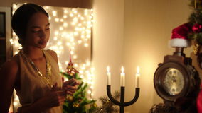 Beautiful black woman waiting for guests coming on new year party stock video