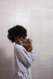 Beautiful black woman wearing  bathrobe Royalty Free Stock Photography