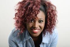 Beautiful black woman on white background. Studio shot Royalty Free Stock Photos