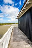 Beautiful house in the basin of Arcachon. Beautiful black wood house on stilts in the basin of Arcachon on the island with birds Royalty Free Stock Photo