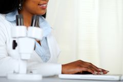 Beautiful black young woman working at laboratory Royalty Free Stock Photo