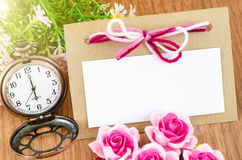 Beautiful Blank paper tag and pocket watch with pink rose. Stock Images