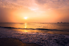 Beautiful blazing sunset landscape at black sea and orange sky Stock Image