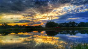 Beautiful Bliss. Gorgeous sunset over peaceful pond Royalty Free Stock Images