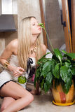 Beautiful blond. Women smelling a flower stock images
