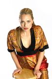 Beautiful Blond. Model leaning on wooden stool Royalty Free Stock Photography