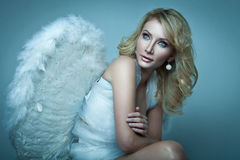 Beautiful blond angel Stock Images