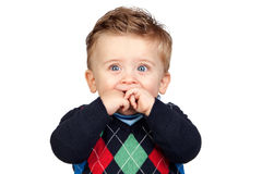 Beautiful blond baby with blue eyes Stock Images