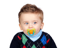 Beautiful blond baby with pacifier Stock Photo
