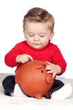 Beautiful blond baby with a piggy-bank Stock Photo