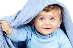 Beautiful blond baby with a towel Royalty Free Stock Photos