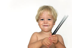 Beautiful blond baby with wooden chopsticks, isola Royalty Free Stock Photo
