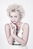 Beautiful blond beauty with original make up Stock Image