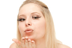 Beautiful blond blowing a kiss Royalty Free Stock Image