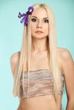 Beautiful blond on the blue background Royalty Free Stock Photos