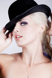 Beautiful blond with blue eyes and a hat Stock Photos