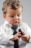 Beautiful blond boy dressed businessman Royalty Free Stock Images