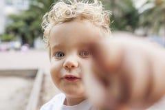 Blond boy plays at park stock photos
