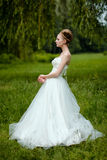 Beautiful blond bride in fashionable wedding dress Royalty Free Stock Photography