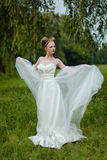Beautiful blond bride in fashionable wedding dress Stock Images