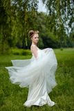 Beautiful blond bride in fashionable wedding dress Royalty Free Stock Image