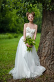 Beautiful blond bride in fashionable wedding dress Stock Photo