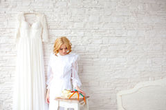 Beautiful blond bride near white brick wall Royalty Free Stock Photography