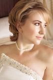 Beautiful blond bride in pearl. Beautiful bride with short blond hair in pearl beaded dress and soft make-up Royalty Free Stock Image