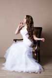Beautiful blond bride portrait in studio. Sensual model Royalty Free Stock Photo