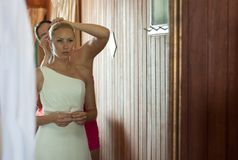 Beautiful blond bride preparing for wedding Royalty Free Stock Images