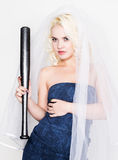 Beautiful blond bride wearing blue dress and weil with professional make-up holding baseboll bat.  Stock Photos