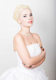 Beautiful blond bride wearing white dress with professional make-up Royalty Free Stock Photos