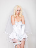 Beautiful blond bride wearing white dress with professional make-up and hairstyle Royalty Free Stock Photo
