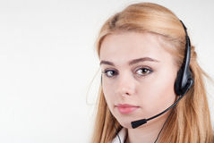 Beautiful blond business woman with headset Royalty Free Stock Photo