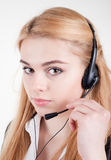 Beautiful blond business woman with headset Royalty Free Stock Images