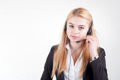 Beautiful blond business woman with headset Stock Photos