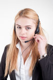 Beautiful blond business woman with headset Stock Photography